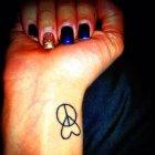 тату сердце и эмблема мира значение.
