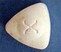 Фото экстази. Изображение экстази с логотипом X.